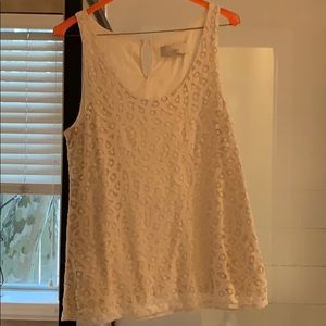 Lift cream colored sleeveless shirt